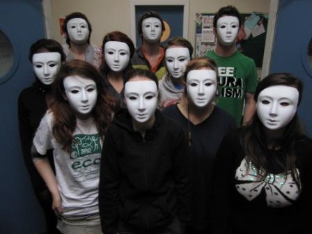 Members of the YAG with their plain masks before the workshop